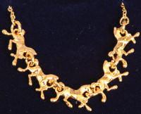 Gold running horse pendant
